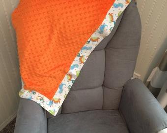 Baby orange dinosaur blanket