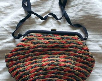 Vintage woven straw shoulder bag. Natural/gold,navy,green and red with navy grosgrain strap