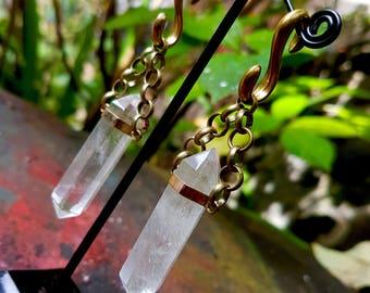 Brass quartz 'Magnitude' ear weights.