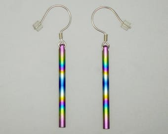 Anodized titanium and sterling silver pair of swinging earrings. Titanium jewelry.