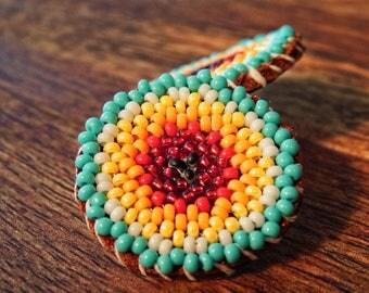 beaded native american sunburst earrings, leather backed post earring, hand beaded rosette earrings, color burst post earrings