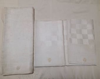 Antique linen fabric tablecloth with 12 napkins.