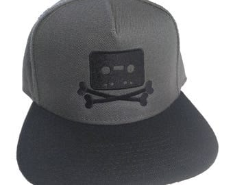The Pirate Bay Cassette Tape Crossbones Logo Embroidered 5-Panel Charcoal Grey Black Hat