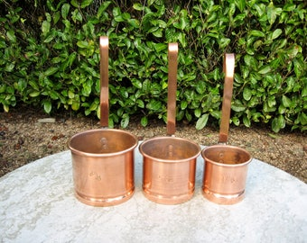A Very Nice Three Piece Set Of French Copper Graduated Measures
