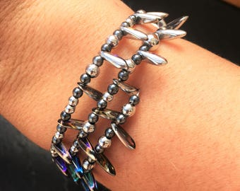 Silver and blue holigraphic wrap-around bracelet.
