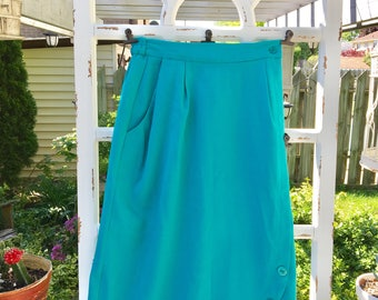 Vintage turquoise skirt with button detail