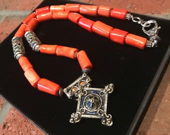 Morrocan Tuareg Tribal berber boghdad old silver cross tafinagh tiznit Amazigh pendant and orange coral beaded necklace.