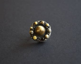 """Silver ring with 10 amber balls """"Parade of planets"""""""