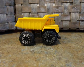 Vintage Remco yellow toy Dump Truck 1987 diecast and plastic
