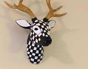 Black and white checkered deer head