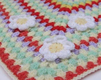 Handmade colourful crochet blanket with daisy detail