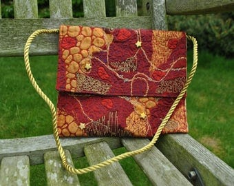 Red and gold embrodered clutch bag