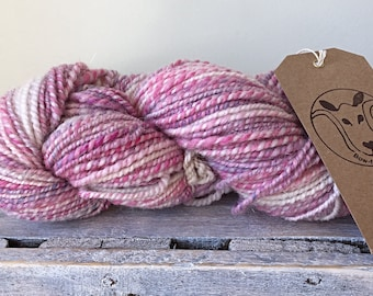Hand spun wool, pretty in pink with tastful added sparkle