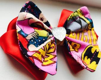 Wonderwoman and Batgirl satin hair bow with headband. Rhinestone center. Halloween
