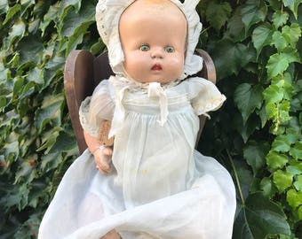 One armed composition baby doll