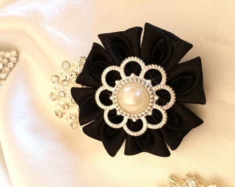 Has black satin ribbon flower - you choose the backing: hair clip, brooch, comb or headband