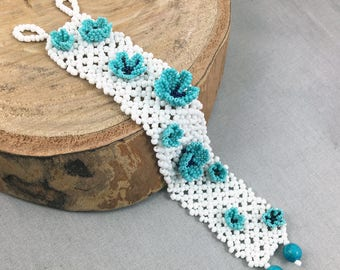 White seed bead net bracelet with turquoise beaded flowers, beaded jewellery