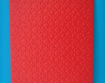 Cut background card embossed red flowers and leaves