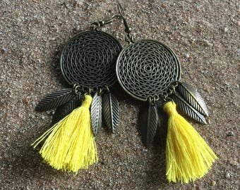 Small bronze disc and yellow tassel earrings