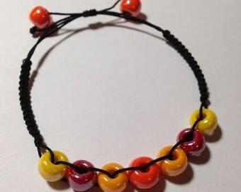 Adjustable bracelet - Orange, yellow and red beads