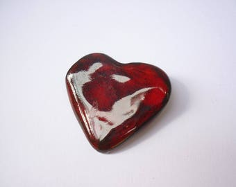 red heart on black clay brooch
