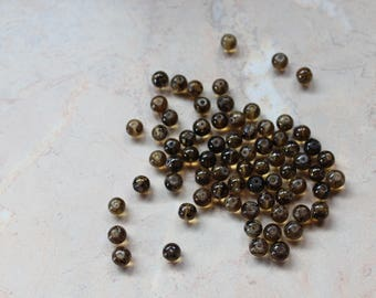 Round glass beads, amber and black. 4mm
