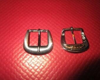 round matte silver metal buckle