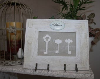 Key holder or jewelry from a wooden frame.