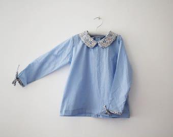 Peter Pan collar and sky blue satin blouse