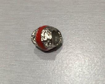 Red enamel and metal bead