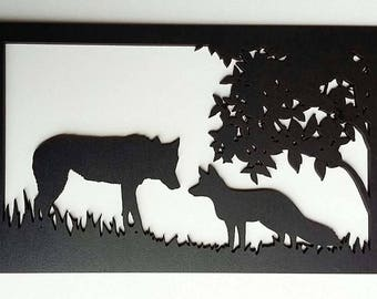 The Wolf and Fox cut and painted wooden