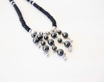 "Necklace ""Waterfall"" of Hematite beads, glass beads black, black nickel metal"