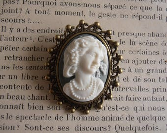 Off-white metal with green and white cameo brooch