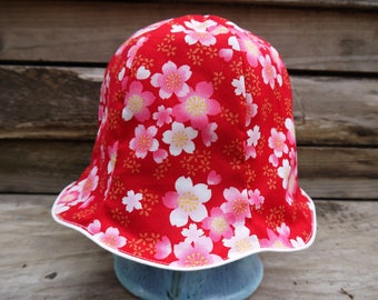 Nice hat with white flowers on red background