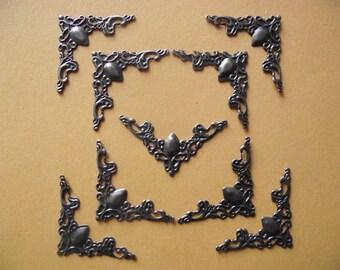 set of 20 corners, angles, filigree embellishments. Antique bronze color