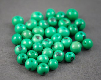 10 pcs - beads spacer • seeds dyed Acais • green • ethnic, nature • 8mm