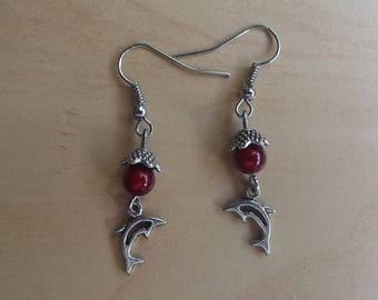 Red stud earrings.
