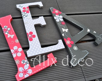 Child name wooden letters painted and decorated by hanging themed flowers and butterflies (made to order)