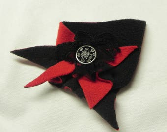 modern graphic brooch made of fleece and his little black lace