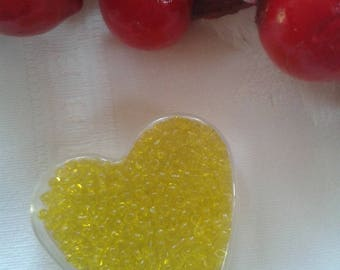 beads seed color yellow in their box transparent heart shape