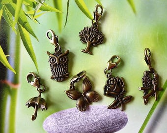 6 pendants charm's romantic bronze with lobster clasp heart 1 OWL 1 umbrella 1 pink parakeet 1 tree 1 Butterfly