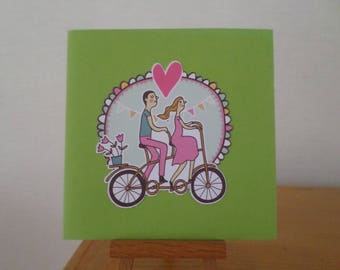 card with couple in love on a tandem