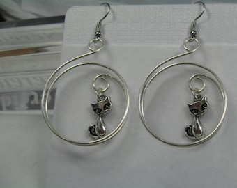 """Kitten heel to the silver hoop"" earrings"