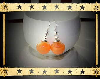 Pearl Orange opaque liquid filled glass globe mounted on silver plated