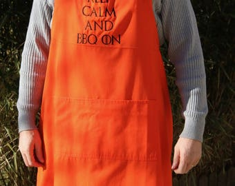 "Large size apron embroidered ""Keep calm and bbq on"" with colors orange, perfect Pocket"
