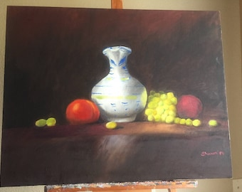 Still life of a vase with fruit