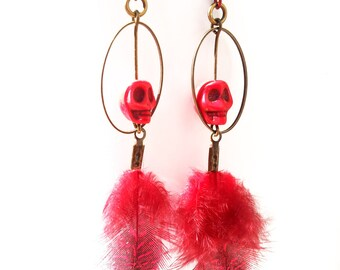 """Earrings """"Red Voodoo"""": speckled feathers and Red skulls."""