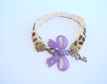 child bracelet bronze purple bow