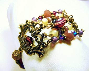 Bronze bracelet, mauve purple, mother of pearl beads, Burgundy Ribbon.