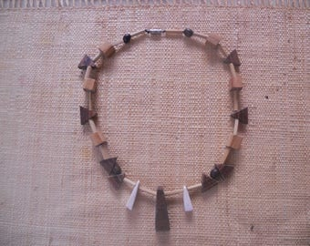 Ethnic necklace with wooden beads, seeds, bone and bamboo